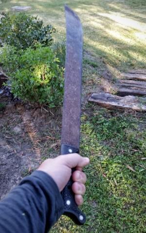Nothing says macho like brandishing a machete.